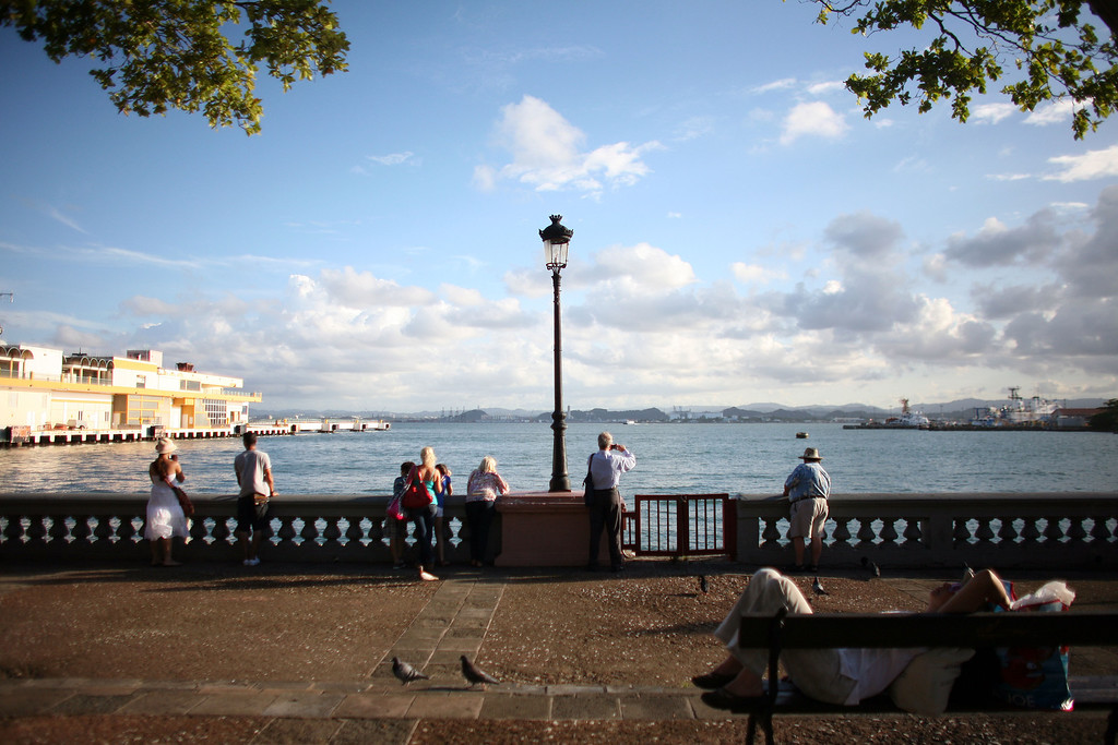 . Tourists look out from the pier near the cruise ship terminal in Old San Juan, Puerto Rico, Wednesday Nov. 23, 2011. . (AP Photo/Ricardo Arduengo)