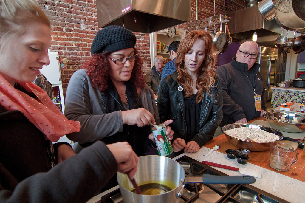 . Chef Dani Fontaine, third from left, observes as participants Andrea, left, Nicole Hamrah and Brian Kelly prepare a cannabis-infused, gluten free trail mix during a cannabis cooking class in Denver, Colorado, on Thursday, April 18, 2013. (Werner R. Slocum/MCT)