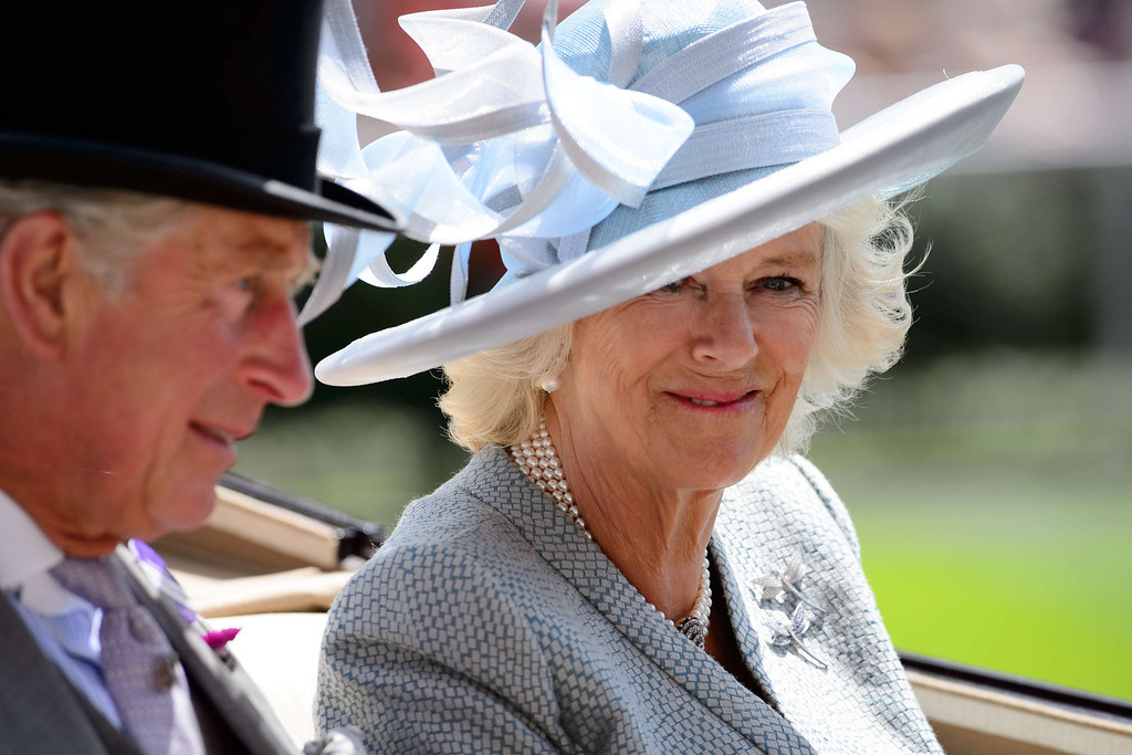 . Britain\'s Prince Charles, Prince of Wales (L) and Camilla, Duchess of Cornwall (R) arrive into the Parade Ring on the first day of the Royal Ascot horse racing meet, in Berkshire, west of London, on June 17, 2014. Horse racing has been held at the famous Berkshire course since 1711 and tradition is a hallmark of the meeting. Top hats and tails remain compulsory in parts of the course while a daily procession of horse-drawn carriages brings the Queen to the course. AFP PHOTO / LEON  NEAL/AFP/Getty Images