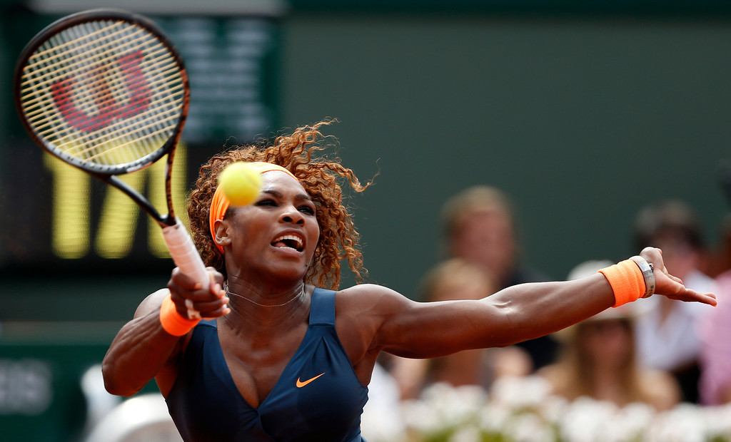 . Serena Williams, of the U.S,  returns the ball to Russia\'s Maria Sharapova during the Women\'s final match of the French Open tennis tournament at the Roland Garros stadium Saturday, June 8, 2013 in Paris. (AP Photo/Petr David Josek)