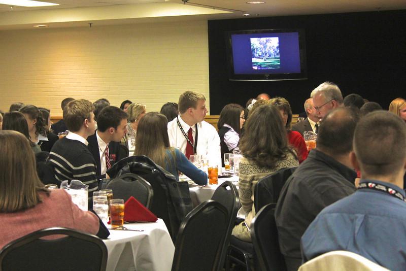The University Fellows enjoy a slideshow at their luncheon.