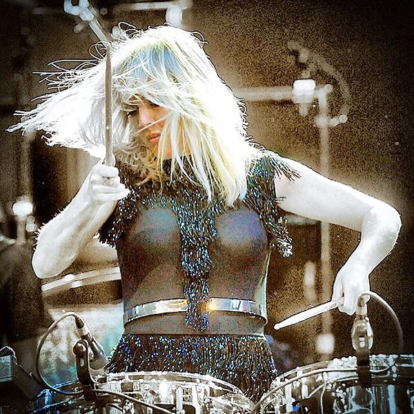 Jack Haley/Messenger Post Media.Ellie Goulding gets after it on the drums during her concert in support of her Derlium album.