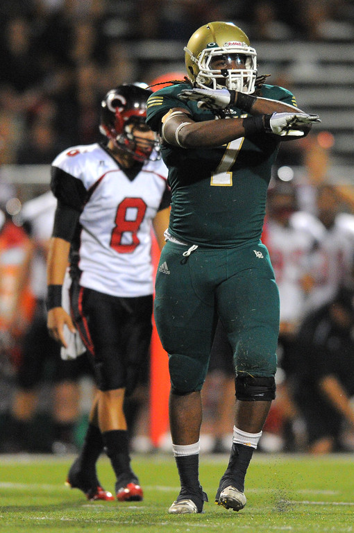 . Long Beach Poly football takes on Centennial (Corona) as part of the Mission Viejo Classic in Mission Viejo, CA on Friday, September 13, 2013. Poly\'s Rodney Shorter celebrates a defensive stop. (Photo by Scott Varley, Press-Telegram)