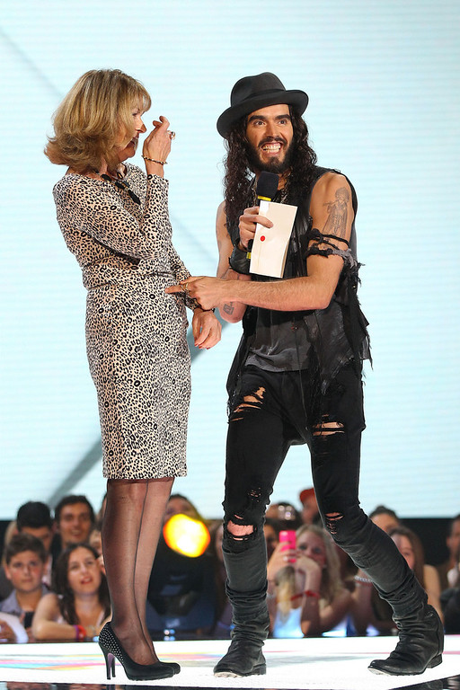 . Russell Brand presents the ARIA for best female artist on stage with his mother Barbara Brand at the 26th Annual ARIA Awards 2012 at the Sydney Entertainment Centre on November 29, 2012 in Sydney, Australia.  (Photo by Don Arnold/Getty Images)