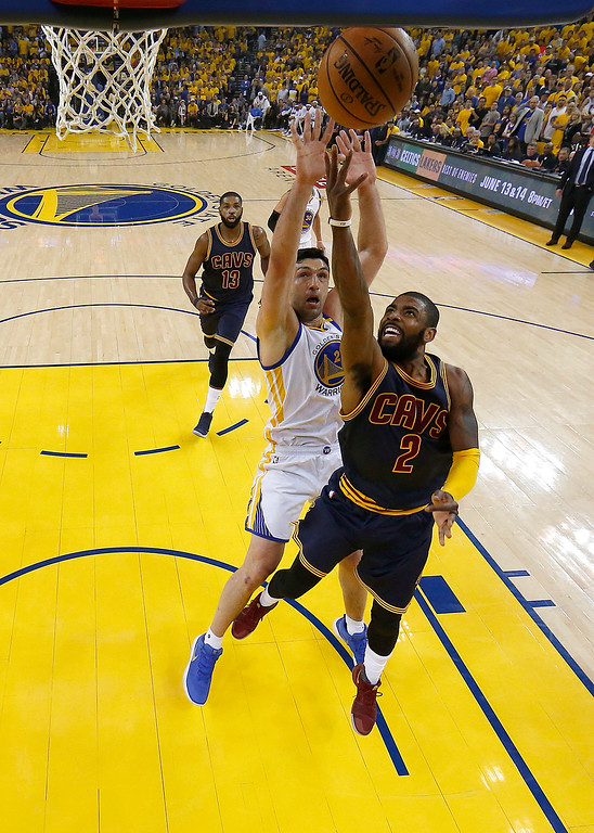 . Cleveland Cavaliers guard Kyrie Irving (2) shoots against Golden State Warriors center Zaza Pachulia during the first half of Game 1 of basketball\'s NBA Finals in Oakland, Calif., Thursday, June 1, 2017. (AP Photo/Marcio Jose Sanchez, Pool)