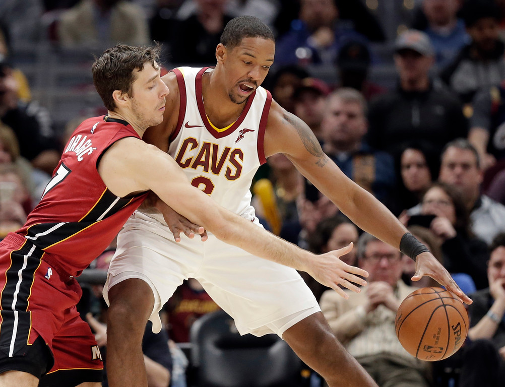 . Cleveland Cavaliers\' Channing Frye, right, drives past Miami Heat\'s Goran Dragic, from Slovenia, in the second half of an NBA basketball game, Tuesday, Nov. 28, 2017, in Cleveland. The Cavaliers won 108-97. (AP Photo/Tony Dejak)