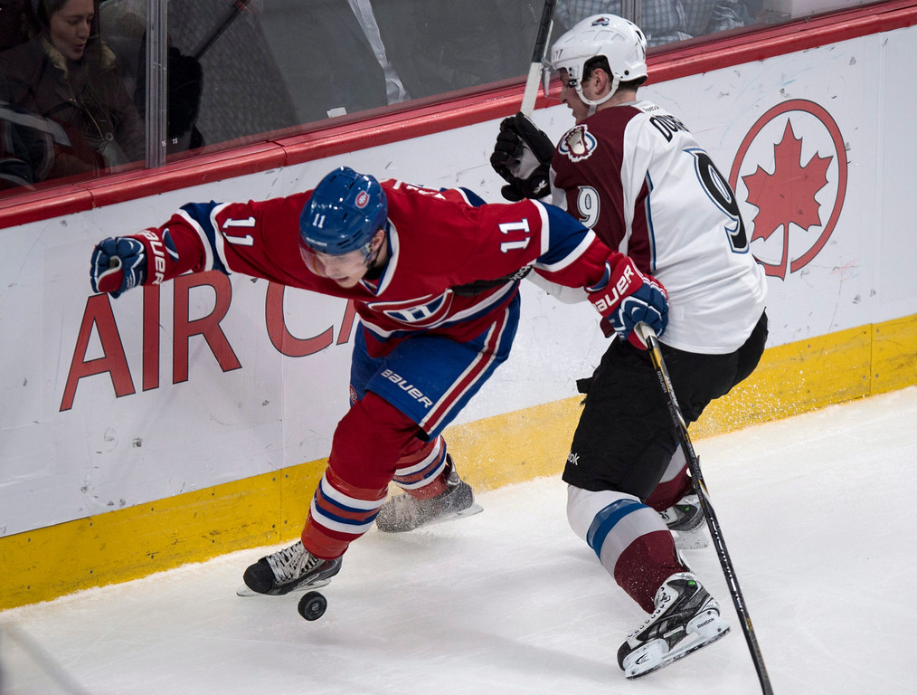 . Montreal Canadiens\' Brendan Gallagher and Colorado Avalanche\'s Matt Duchene battle for procession of the puck during first period NHL hockey action Tuesday, March 18, 2014 in Montreal. (AP Photo/The Canadian Press, Paul Chiasson)