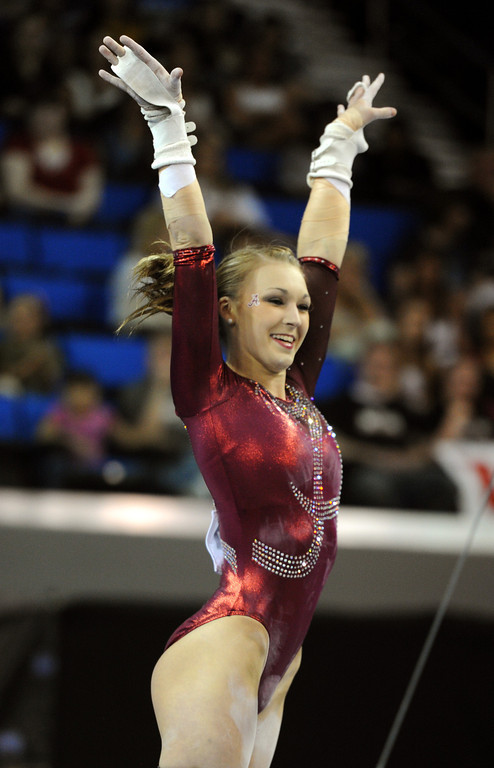 . Alabama\'s Becca Alexin finishes the uneven parallel bars Friday, April 19, 2013, at the NCAA Women\'s Gymnastics Championships at Pauley Pavilion. (Michael Owen Baker/Staff Photographer)