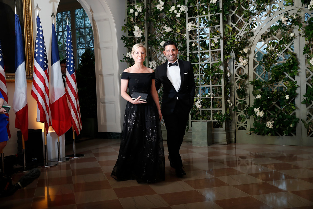 . Homeland Security Secretary Kirstjen Nielsen, left, and Chad Wolf arrive for a State Dinner with French President Emmanuel Macron and President Donald Trump at the White House, Tuesday, April 24, 2018, in Washington. (AP Photo/Alex Brandon)