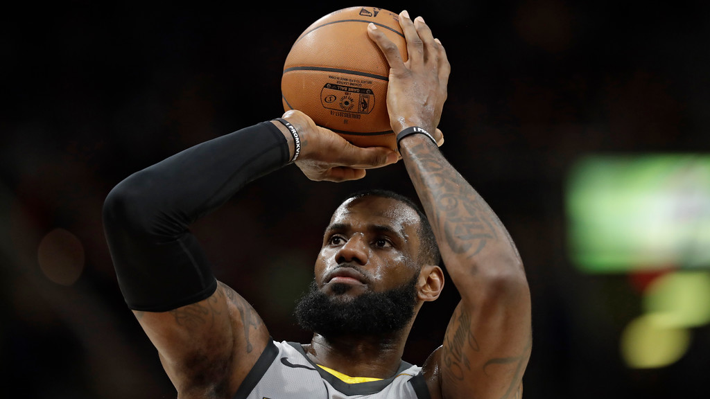 . Cleveland Cavaliers\' LeBron James shoots against the Denver Nuggets in the first half of an NBA basketball game, Saturday, March 3, 2018, in Cleveland. (AP Photo/Tony Dejak)