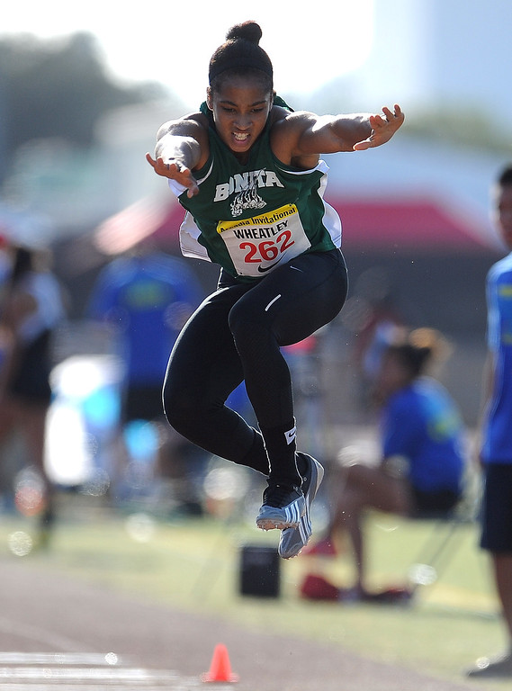 . Bonita\'s Dominique Wheatly competes in the triple jump during the Arcadia Invitational at Arcadia High School on Saturday, April 6, 2013 in Arcadia, Calif.  (Keith Birmingham Pasadena Star-News)
