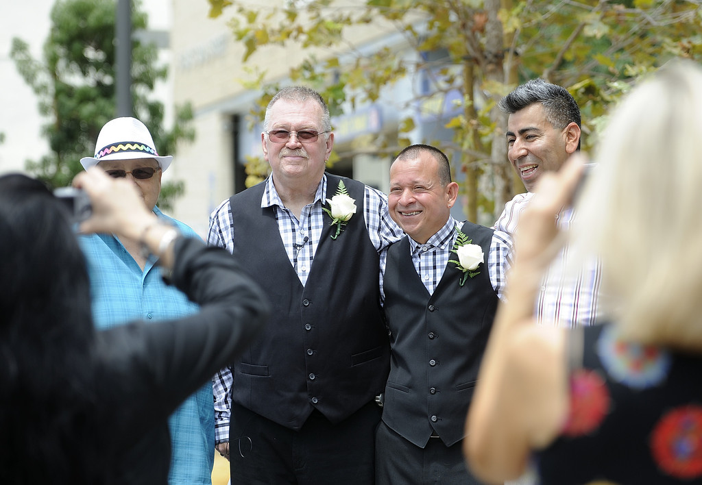 . LONG BEACH, CALIF. USA -- Long Beach residents Bob Crow, left, and Tony Almeida, pose for pictures after getting married at Harvey Milk Plaza in Downtown Long Beach, Calif., on July 1, 2013. Long Beach Mayor Bob Foster performed the marriage ceremony for the couple. Crow, who founded Long Beach Pride, asked Foster to perform the ceremony years ago.  Photo by Jeff Gritchen / Los Angeles Newspaper Group