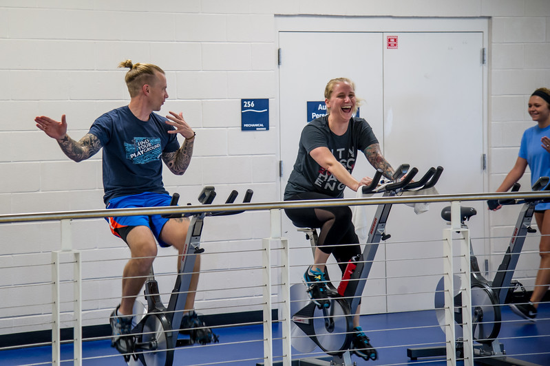 Students Micheal Beat and Lindsey Beat in the Dugan Wellness Center.