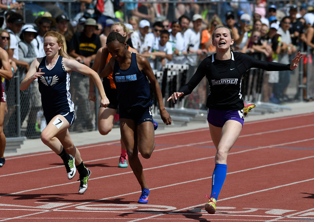 . Lauren Gale, Discovery Canyon, right, edges out Maya Evans, Vista Peak, center, and Tess Bode, Valor Christian, left, during the 4A 100 meter dash final at the Colorado Track and Field State Championships at Jeffco Stadium May 21, 2016. Gale won with a time of 12.21.(Photo by Andy Cross/The Denver Post)