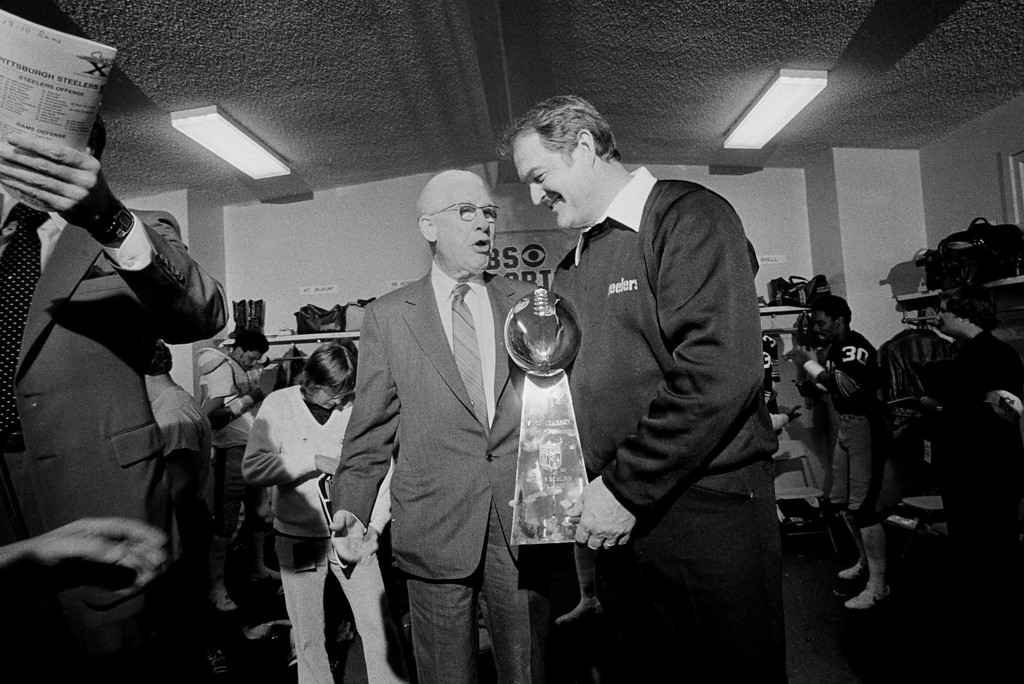 . Pittsburgh Steelers\' board chairman Art Rooney, left, talks with Steelers\' coach Chuck Noll after presentation of the Super Bowl XIV trophy in the Steelers\' locker room at the Rose Bowl in Pasadena, Calif., Jan. 20, 1980.  (AP Photo/Harry Cabluck)