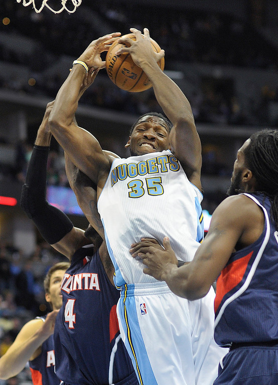 . Nuggets forward Kenneth Faried fought for a rebound in the first half.   Photo By Karl Gehring/The Denver Post