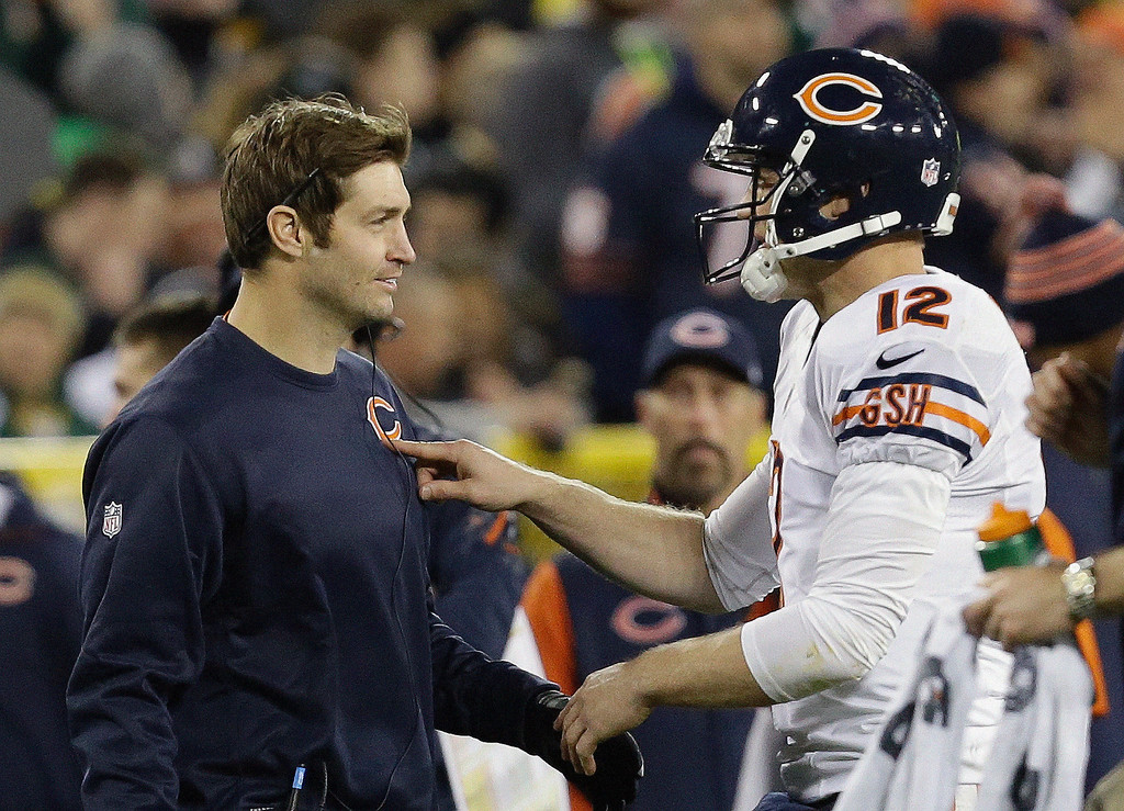 . Chicago Bears quarterback Josh McCown (12) talks to Jay Cutler during the first half of an NFL football game against the Green Bay Packers Monday, Nov. 4, 2013, in Green Bay, Wis. (AP Photo/Mike Roemer)