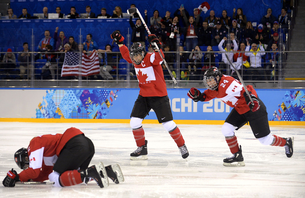 . Canada\'s players celebrate after a goal during the Women\'s Ice Hockey Group A match between Canada and USA at the Sochi Winter Olympics on February 12, 2014 at the Shayba Arena. AFP PHOTO / ALEXANDER NEMENOV/AFP/Getty Images
