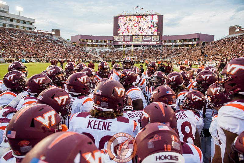 The Hokies huddle up before the matchup between Virginia Tech and Florida State at Doak Campbell Stadium, Monday, Sept. 3, 2018. (Photo by Cory Hancock)