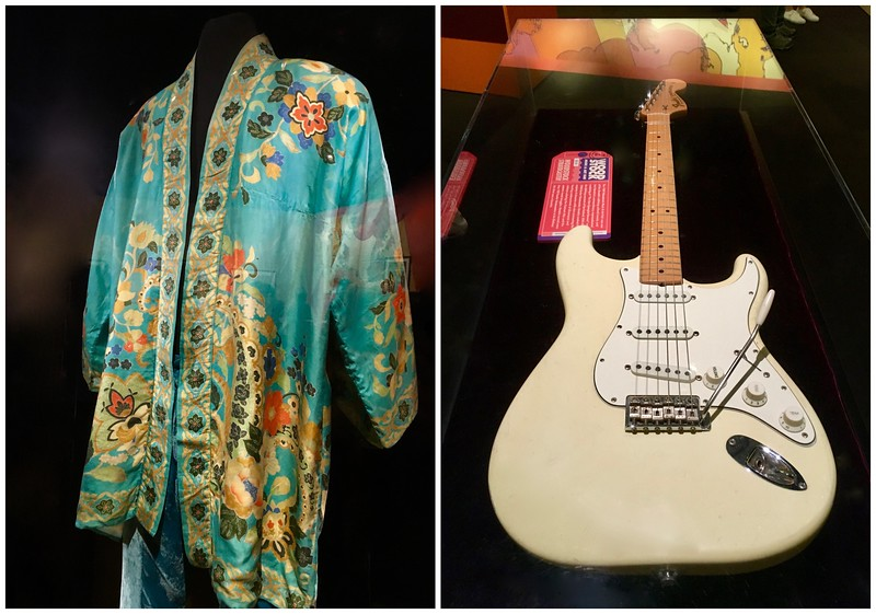 a blue and flowered robe and white guitar