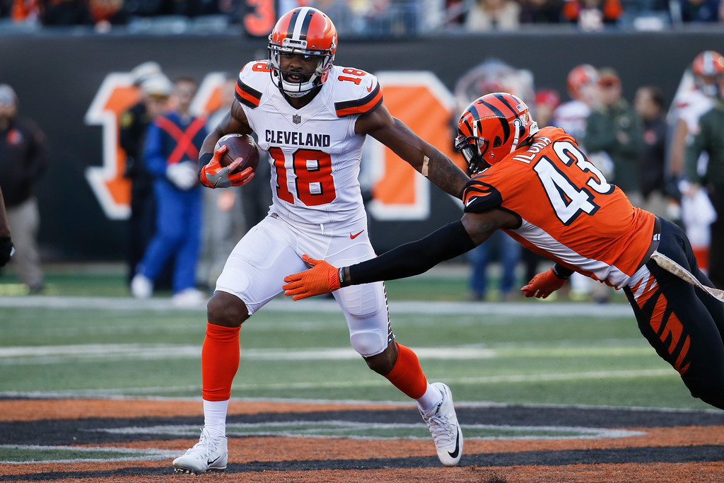 . Cleveland Browns wide receiver Kenny Britt (18) runs the ball against Cincinnati Bengals free safety George Iloka (43) in the second half of an NFL football game, Sunday, Nov. 26, 2017, in Cincinnati. (AP Photo/Frank Victores)