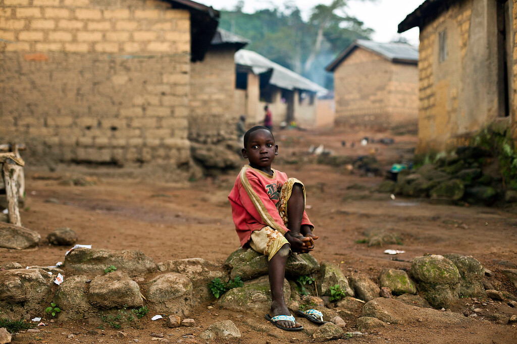 . In this photo taken Sunday Nov. 23, 2014, a child sits in the Guinean village of Meliandou, some 400 miles (600 kms) south-east of Conakry, Guinea, believed to be Ebola\'s ground zero.  (AP Photo/Jerome Delay)