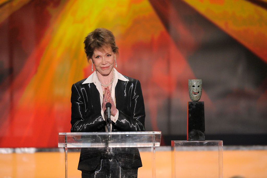 . Mary Tyler Moore accepts the Life Achievement award at the 18th Annual Screen Actors Guild Awards on Sunday Jan. 29, 2012 in Los Angeles. Moore died Jan. 25 at age 80. (AP Photo/Mark J. Terrill)