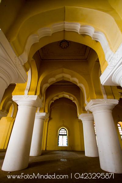 Inside Thirumalai Nayakkar Mahal, Madurai, India. The huge supporting pillar needs atleast 5 adults to make a human chain around it.