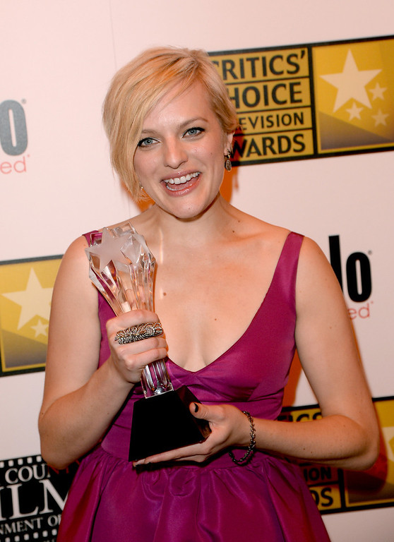""". Actress Elisabeth Moss wins the award for Best Actress in a Movie or Miniseries for \""""Top of the Lake\"""" at the Broadcast Television Journalists Association\'s third annual Critics\' Choice Television Awards at The Beverly Hilton Hotel on June 10, 2013 in Los Angeles, California.  (Photo by Jason Merritt/Getty Images for CCTA)"""