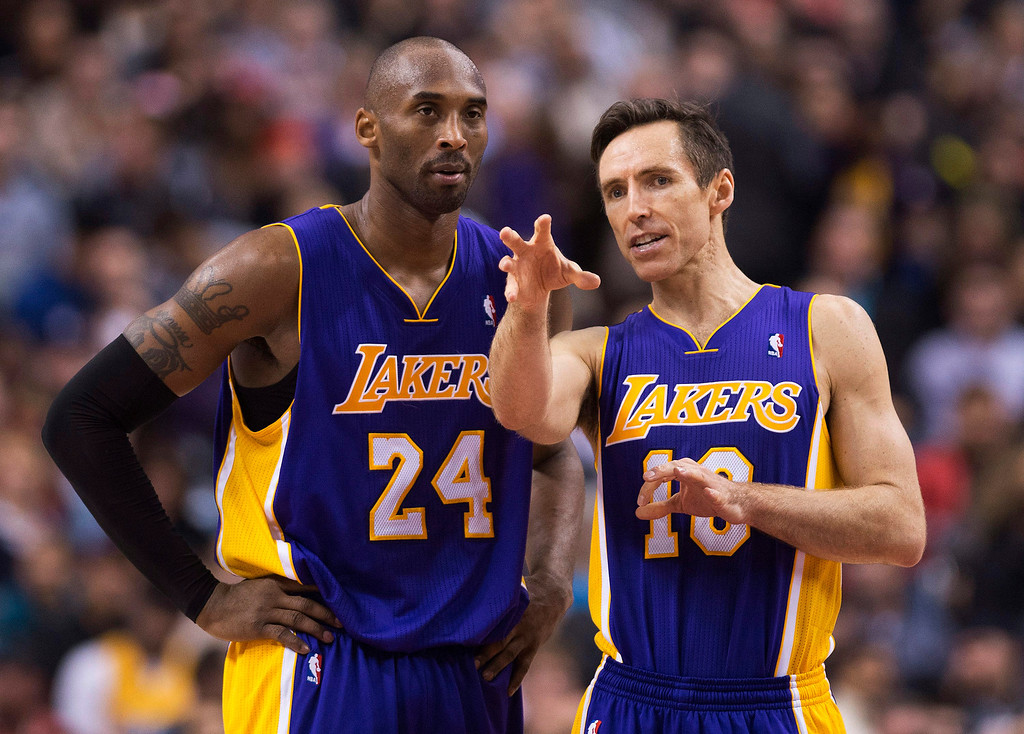 . Los Angeles Lakers guards Kobe Bryant, right, and Steve Nash, right, talk during a time-out while playing against the Toronto Raptors during first half NBA basketball action in Toronto on Sunday Jan. 20, 2013. (AP Photo/THE CANADIAN PRESS,Nathan Denette)