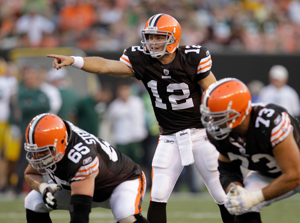 . Cleveland Browns quarterback Colt McCoy points out a play over guard Eric Steinbach (65) and offensive tackle Joe Thomas in the first quarter of their preseason NFL football game against the Green Bay Packers on Saturday, Aug. 13, 2011, in Cleveland.  (AP Photo/Tony Dejak)