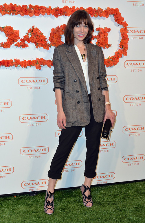 . Actress Milla Jovovich attends the 3rd Annual Coach Evening to benefit Children\'s Defense Fund at Bad Robot on April 10, 2013 in Santa Monica, California.  (Photo by Alberto E. Rodriguez/Getty Images)