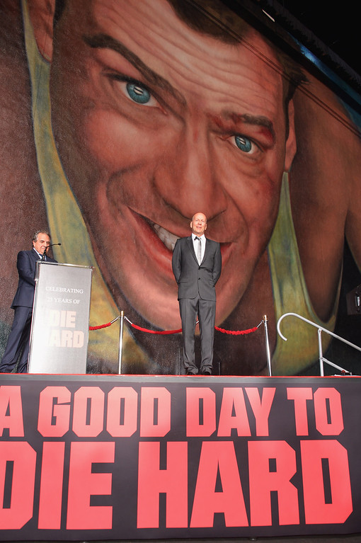 """. CENTURY CITY, CA - JANUARY 31:  Actor Bruce Willis (C)  and Co-Chairman & Chief Executive Officer of Fox Filmed Entertainment Jim Gianopulos attend the dedication and unveiling of a new soundstage mural celebrating 25 years of \""""Die Hard\"""" at Fox Studio Lot on January 31, 2013 in Century City, California.  (Photo by Alberto E. Rodriguez/Getty Images)"""