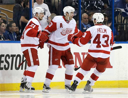 . Detroit Red Wings center Pavel Datsyuk (13), of Russia, celebrates his goal against the Tampa Bay Lightning with left wing Tomas Tatar (21), of Slovakia, and center Darren Helm (43) during the second period of Game 1 of an NHL hockey first-round playoff series Thursday, April 16, 2015, in Tampa, Fla. (AP Photo/Chris O\'Meara)