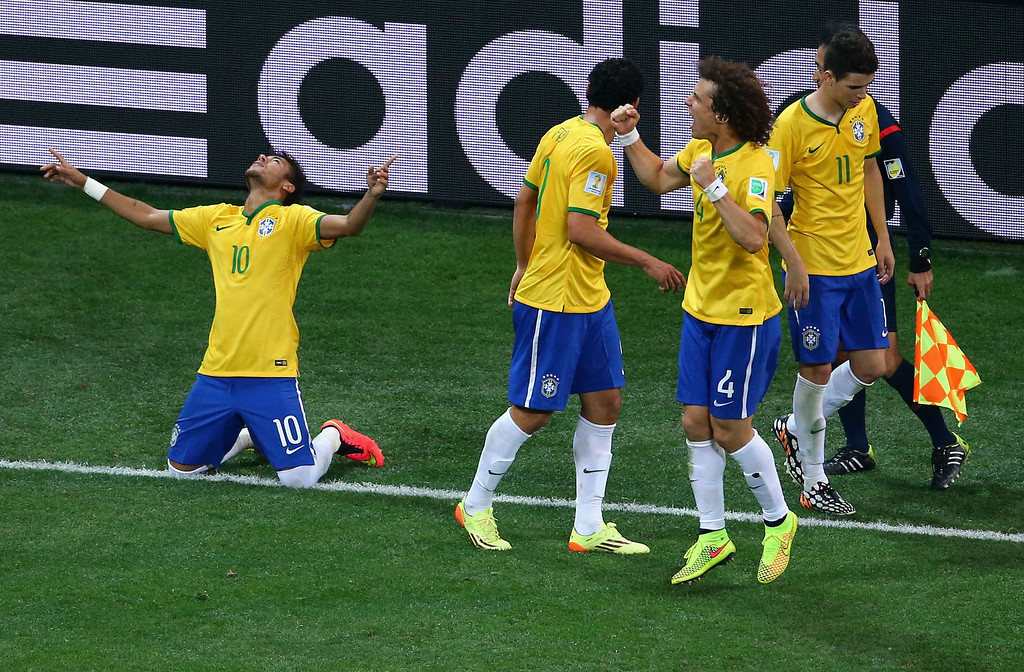 . Neymar of Brazil (L) celebrates after his second goal on a penalty kick with teammates during the 2014 FIFA World Cup Brazil Group A match between Brazil and Croatia at Arena de Sao Paulo on June 12, 2014 in Sao Paulo, Brazil.  (Photo by Elsa/Getty Images)