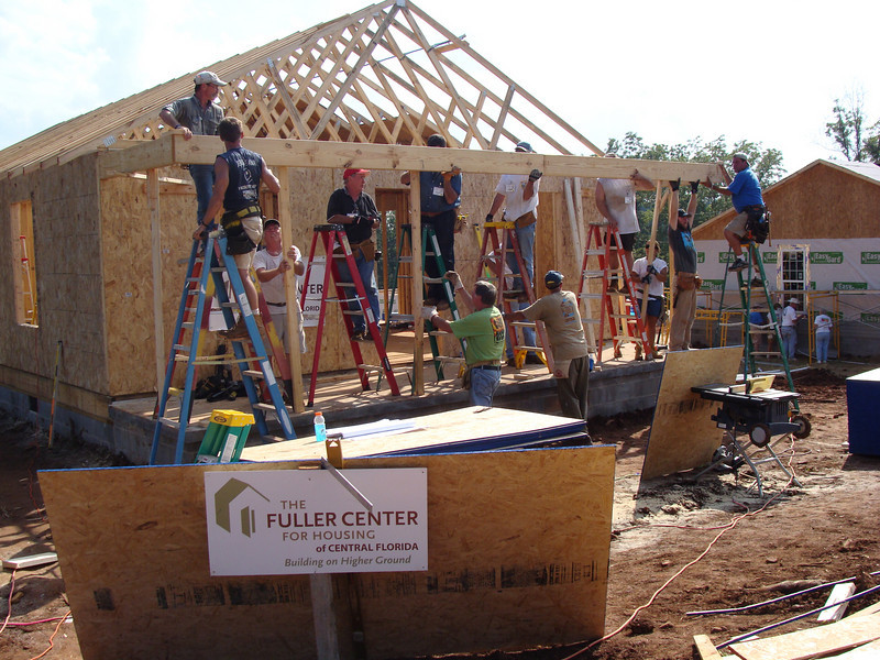 A bee-hive of building on Day 1 of Millard Fuller Legacy Build in Lanett, AL. kl-b