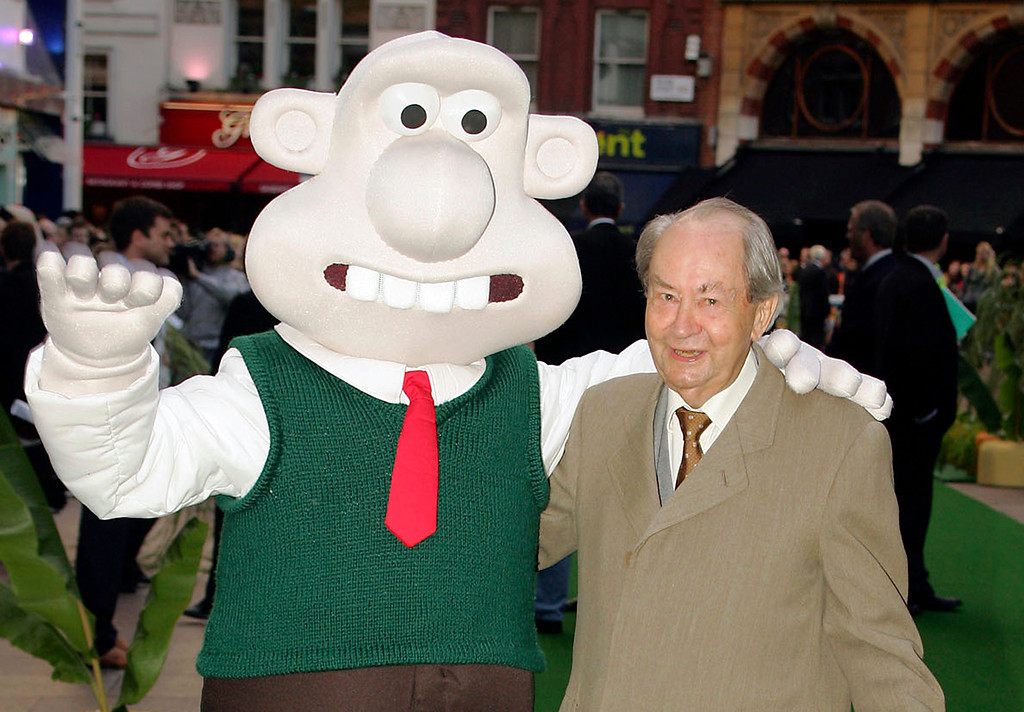 """. FILE - In this Sunday, Oct. 2, 2005 file photo, British actor Peter Sallis, who voices the part of Wallace poses with a person dressed as the character \'Wallace\' on arrival at the Leicester Square Odeon, London for the premiere of Wallace & Grommit: The Curse of the Were-Rabbit. Sallis, who played irrepressible, cheese-loving inventor Wallace in the \""""Wallace and Gromit\"""" cartoons, has died. He was 96. Sallis\' agents, Jonathan Altaras Associates, say he died Friday, June 2, 2017 in London. (AP Photo/Paul Ashby, File)"""