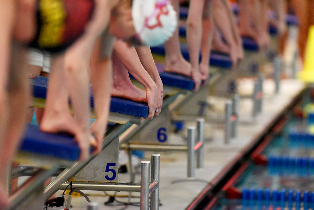 . The athletes prepared for the start of the 100 Yard Freestyle race during the girls 5A State Swim meet held at Edora Pool and Ice Center on Saturday. (Photo by Kira Horvath/ The Denver Post)