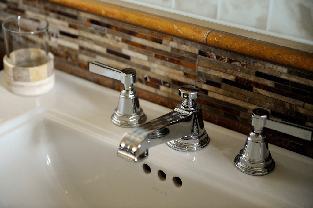 . DENVER, CO - NOVEMBER 13: Details in a guest bathroom of the Spicer residence on November 13, 2013, in Denver, Colorado. Jeannine Spicer worked to preserve elements of her childhood home, such as the hardware on the sinks throughout the house, which are similar to the originals. (Photo by Anya Semenoff/YourHub)