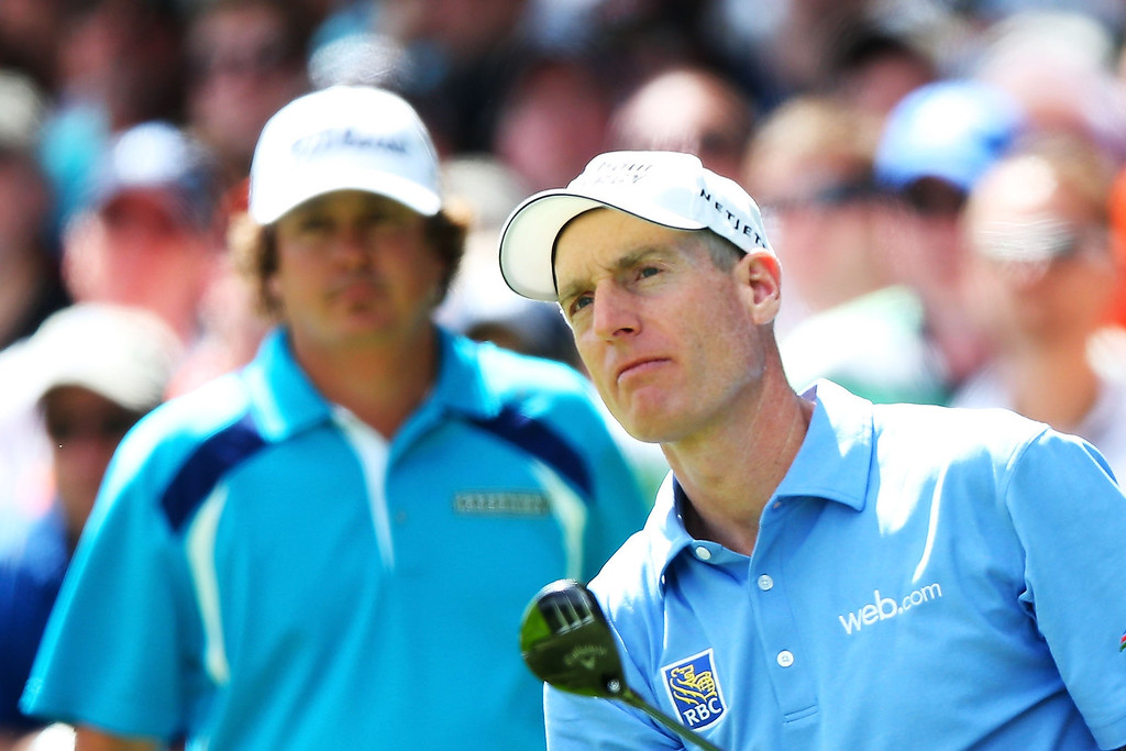 . Jim Furyk of the United States watches his tee shot on the first hole as Jason Dufner of the United States looks on during the final round of the 95th PGA Championship on August 11, 2013 in Rochester, New York.  (Photo by Andrew Redington/Getty Images)