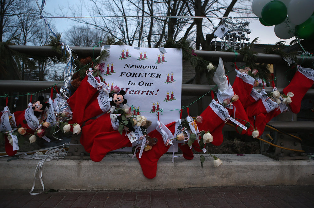 . Stockings hang at a streetside memorial for 20 children who were killed at Sandy Hook Elementary School on December 20, 2012 in Newtown, Connecticut. Six funeral services were held Thursday in the Newtown area for students and teachers slain in the attack.  (Photo by John Moore/Getty Images)