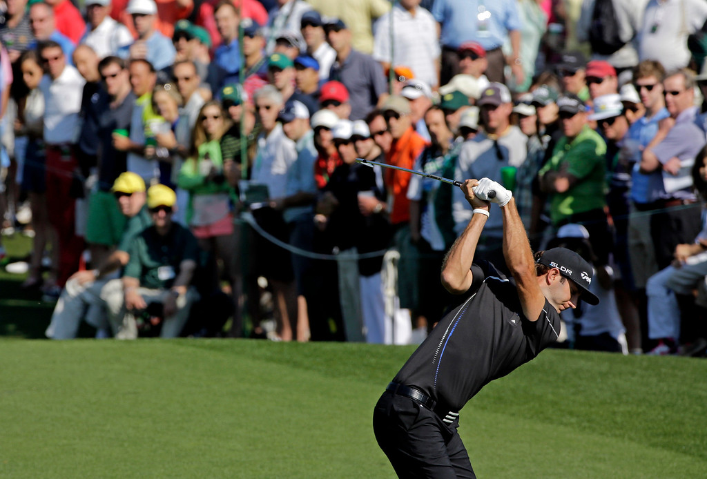 . Dustin Johnson tees off on the third hole during the second round of the Masters golf tournament Friday, April 11, 2014, in Augusta, Ga. (AP Photo/David J. Phillip)