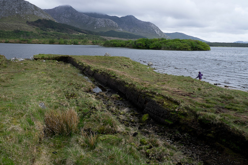 A spit that extended into the fjord in Connemara (west of Galway).  The dark cut in the land is where peat was harvested.