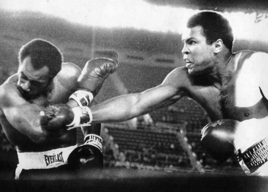 . Muhammad Ali drives a right to the head of Ken Norton in the second round of their heavyweight title bout 9/28/76. Denver Post Library photo archive