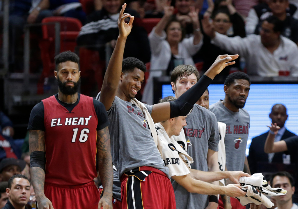 . Miami Heat\'s Hassan Whiteside, second from left, reacts from the bench with James Johnson (16) during the second half of an NBA basketball game against the Cleveland Cavaliers, Saturday, March 4, 2017, in Miami. (AP Photo/Lynne Sladky)