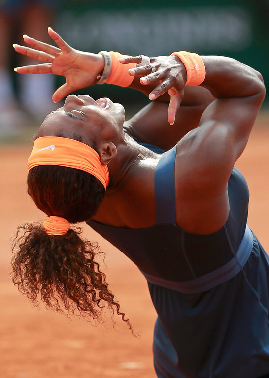 . Serena Williams of the U.S. celebrates defeating Maria Sharapova of Russia in their women\'s singles final match to win the French Open tennis tournament at the Roland Garros stadium in Paris June 8, 2013. Serena Williams proved an irresistible force once more as she powered past Maria Sharapova 6-4 6-4 to win the French Open for the second time on Saturday - 11 years after her first triumph.      REUTERS/Vincent Kessler