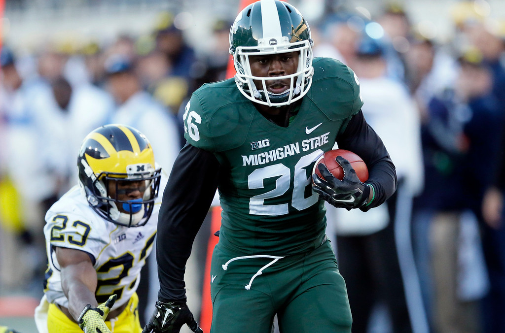 . Michigan State  defensive back Jalen Watts-Jackson (20) outruns Michigan wide receiver Dennis Norfleet (23) as he returns an interception for a touchdown during the second half of an NCAA college football game in East Lansing, Mich., Saturday, Oct. 25, 2014. (AP Photo/Carlos Osorio)