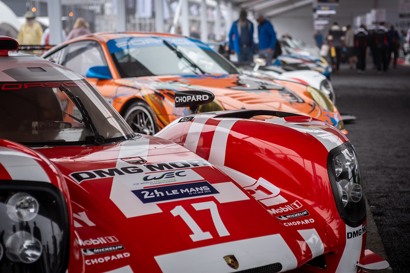 The lineup of cars in the Chopard Heritage Display. Foreground: 2015 919 #17; Background: 2011 911 RSR #80.