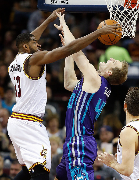 . Cleveland Cavaliers\' Tristan Thompson (13) blocks a shot by Charlotte Hornets\' Cody Zeller (40) during the first half of an NBA basketball game Sunday, Nov. 13, 2016, in Cleveland. (AP Photo/Ron Schwane)
