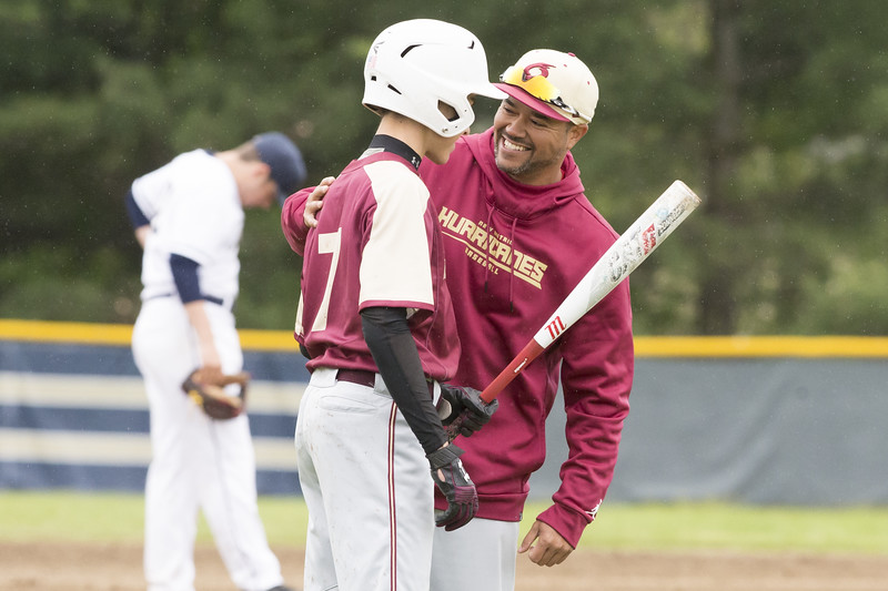 05/14/19  Wesley Bunnell | Staff  Newington baseball defeated New Britain 4-3 in a walk off on Tuesday afternoon at Newington High School. Head Coach Roberto Mercado speaks with Ryan Lipinski (7).